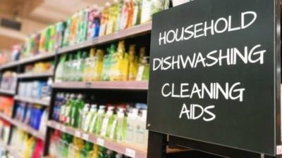 Household, dish wash and cleaning aids signage grocery category aisle at supermarket